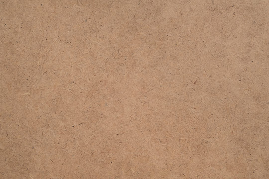 Construction material. Brown plywood texture abstract art background. Solid color LDF surface. Empty space.