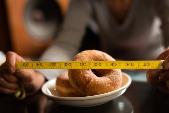 donuts with tailor measuring tape