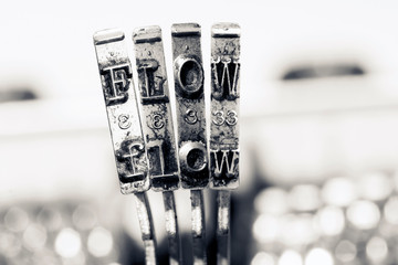 the word FLOW  with old typewriter