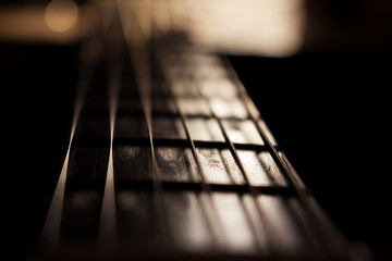 Acoustic Guitar In Music Studio Close up. Shined By The Sun At The Golden Hour