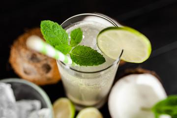 Fotoväggar - Coconut water drink on dark background