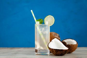 Fotoväggar - Coconut water drink on blue background