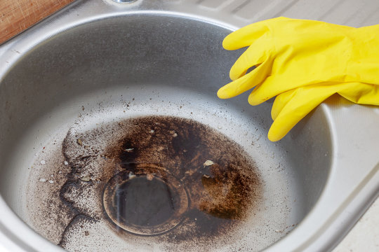 Dirty Sink at kitchen room. Clean a sink drain. unclog a kitchen sink without a disposal