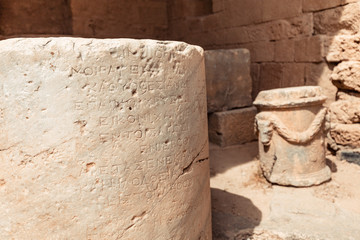 30 May 2019, Lindos, Greece: Ancient Greek inscriptions on stone columns at the archaeological site of Lindos Acropolis