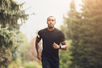 Fit African-American Guy Running In The Park