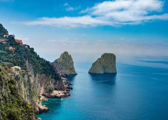Tuinposter Blauwe hemel Faraglioni rocks view from Giardini di Augusto in Capri, Italy.