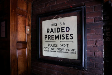 A sign that was reportedly hung following the police raid in 1969 is displayed in The Stonewall Inn in New York