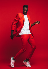 Man dancing on red background