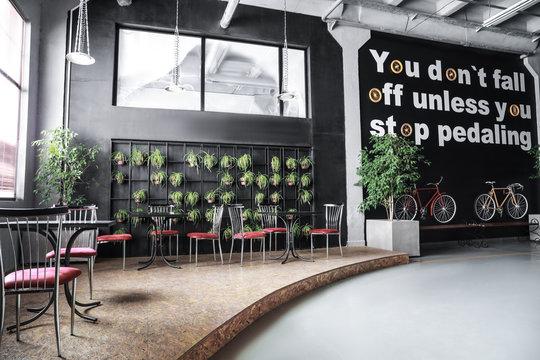 Interior of modern cafe in big business center