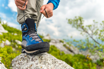 Male Hiker Tying Boot Laces