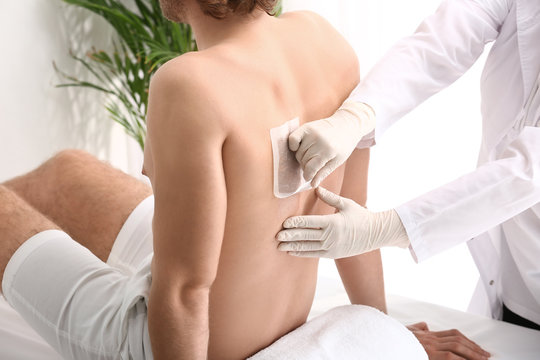 Young man during epilation in beauty salon