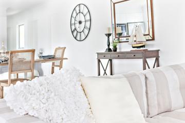 Luxury looking white sofa set near wooden table.