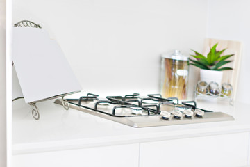 Close up of gas cooker with glass bottles.