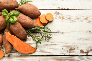 Sweet potato on white wooden background Wall mural