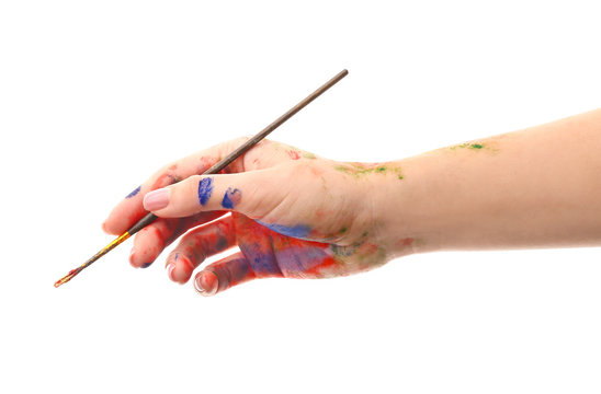 Painted female hand with brush on white background
