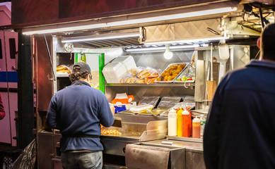 New York, Broadway at night. Take away fast food kiosks selling hot dog