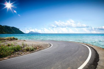 Summer road background of free space for your decoration and ocean landscape.