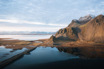 View of road passing through Stokksnes Beach during sunset