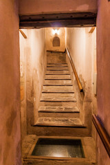 NIZWA, OMAN - MARCH 3, 2017: Stairway of the tower of Nizwa Fort with a booby trap, Oman