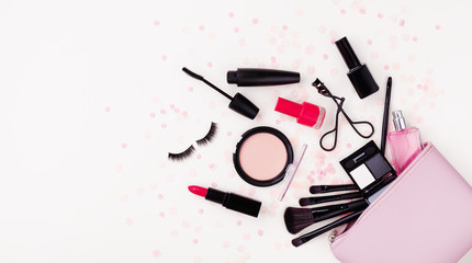 Woman makeup background with beauty products and cosmetics. Top view and flat lay style. Banner format...