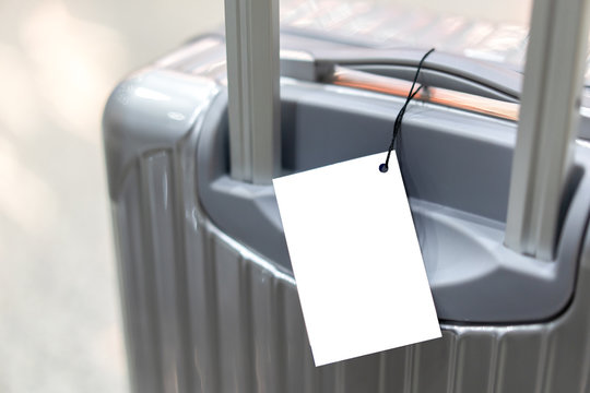 blank luggage tag label on suitcase or bag with TRAVEL INSURANCE ,traveling luggages in an airport terminal,before passenger  and plane flying over sky,Can be used for montage or display your products