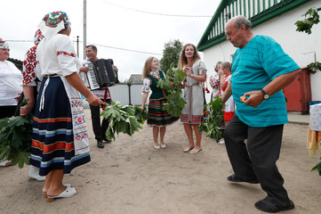 """Villagers take part in a rite called """"Vadzhenne kusta"""" or """"Leading the bush"""" in the village of Lobcha"""