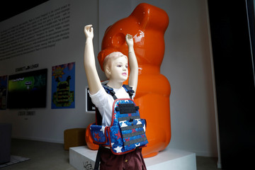 "A child mannequin is seen wearing a bullet proof vest as part of an art installation by artist WhIsBe titled ""Back to School Shopping"" to illustrate the dangers of gun violence in schools, at a gallery in New York City"
