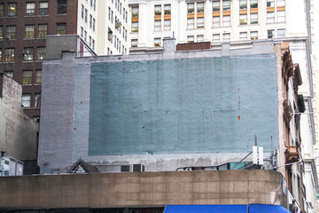 Side of a building in New York with painted-over advert space