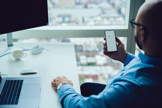Businessman checking calendar on smartphone