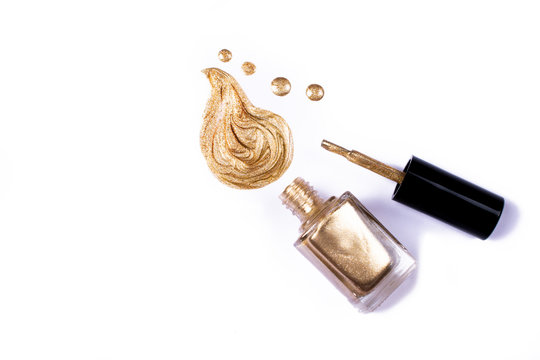 Golden nail polish isolated on white.
