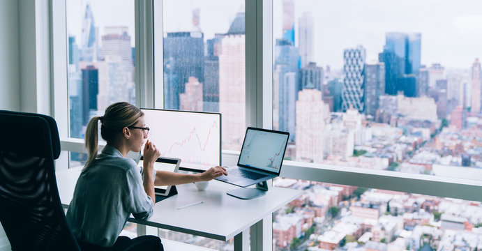 Professional woman working at desk in office
