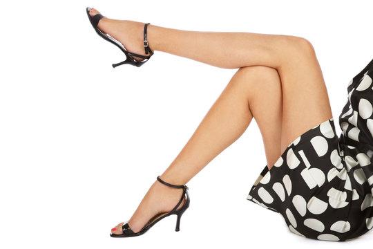 Long slim woman legs in stylish stilettos over white background