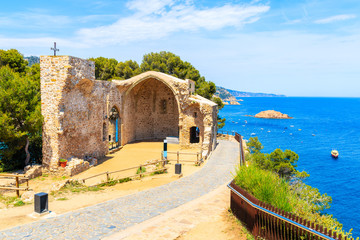 Fototapete - Ruins of old church in Tossa de Mar town on castle hill, Costa Brava, Spain