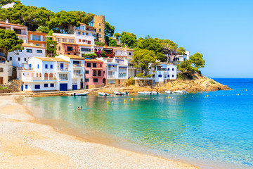 Colorful houses in sea bay with beach in Sa Tuna coastal village, Costa Brava, Spain