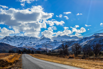 Picture perfect snow capped Drakensberg mountains and green plains in Underberg near Sani pass South Africa