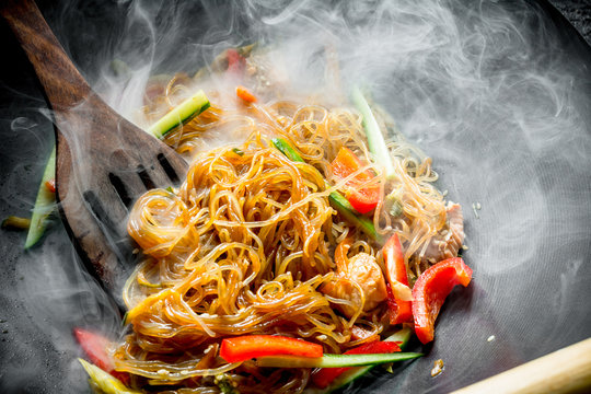 Hot Asian cellophane noodles with vegetables and salmon.