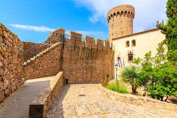 Wall Mural - Castle tower and gardens in old town of Tossa de Mar, Costa Brava, Spain