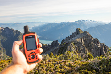 Hiker uses GPS device to navigate route ahead.