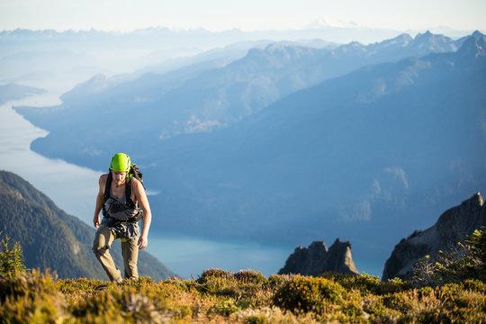 Climber approaches the summit of Douglas Peak, British Columbia.