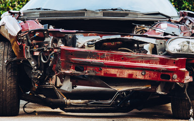 Crashed muscle car close up front bumper