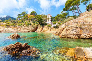 Fototapete - View of beach and small castle in Fornells village, Costa Brava, Spain
