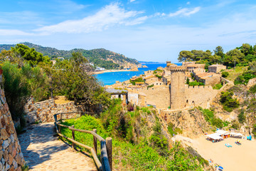Wall Mural - Coastal path in Tossa de Mar and view of castle and old town, Costa Brava, Spain