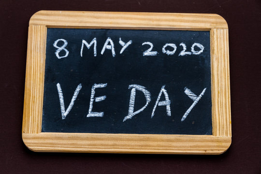 Old fashioned school writing slate with 8 May 2020 VE Day.