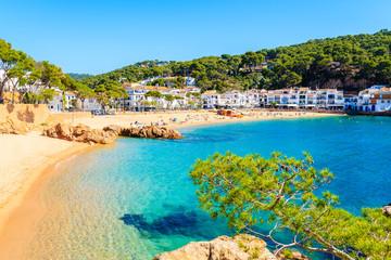 Wall Mural - Stunning sandy beach and azure blue water of sea bay in Tamariu seaside town, Costa Brava, Spain