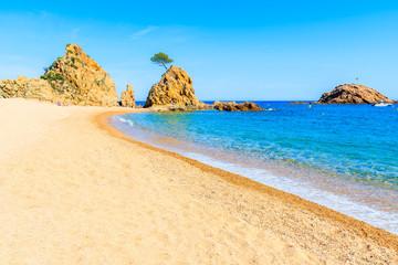Wall Mural - Azure blue water on idyllic beach in Tossa de Mar town, Costa Brava, Spain