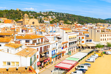 Fototapete - White houses and church in old town of Tossa de Mar, Costa Brava, Spain