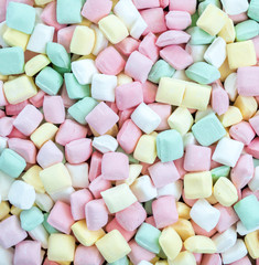 background texture - full frame jumble of colorful pastel butter mints