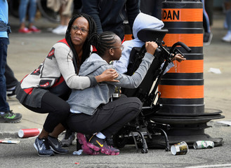 People take cover after reports of shots fired at Toronto Raptors victory parade in Toronto