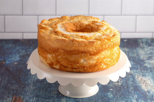 An angel Food Cake On a White Cake Stand