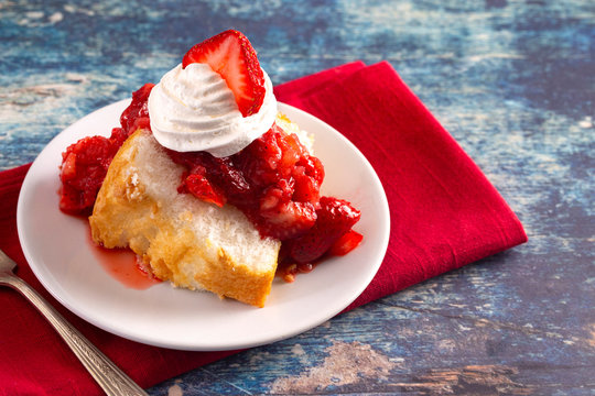 Slice of Strawberry Short Cake Made with Angel Food Cake and Strawberry Sauce